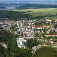 Luftbildaufnahme mit Blick über die PM Oelsa GmbH auf Rabenau und Freital im Hintergrund